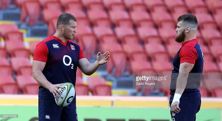 England captain and hooker Dylan Hartley (L) talks to reserve hooker Luke Cowan-Dickie duirng the England captain's run held at the Suncop Stadium on June 10, 2016 in Brisbane, Australia.