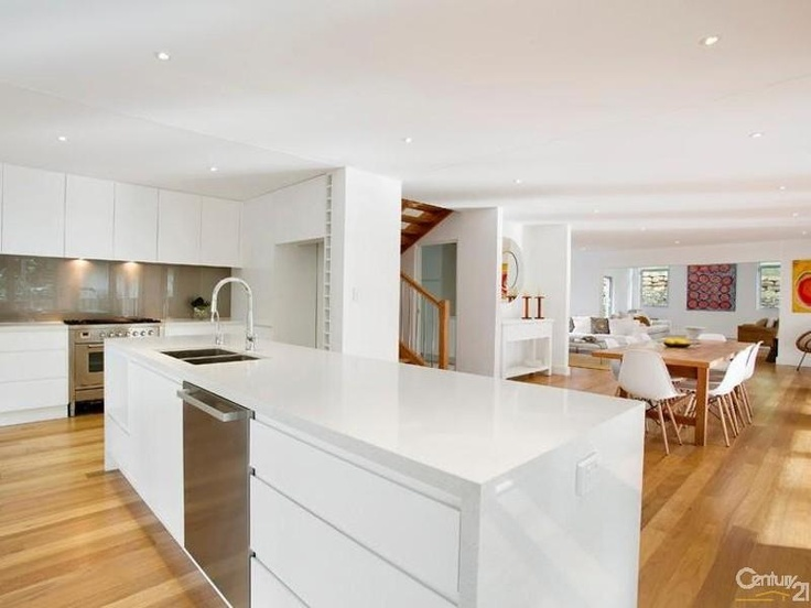 Open plan kitchen, dining and living - love the floors!