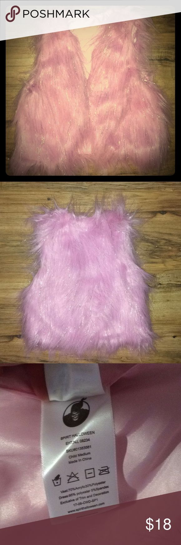 NWOT Pink Faux Fur Vest Super cute bubble gum pink faux fur vest with silver tinsel throughout.  Brand new and never worn. Bought for Halloween but didn't end up using it. Child's medium. Jojo Siwa Shirts & Tops
