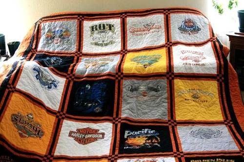 quilt made from sentimental t-shirts.. doing this with my grandmas shirts :)