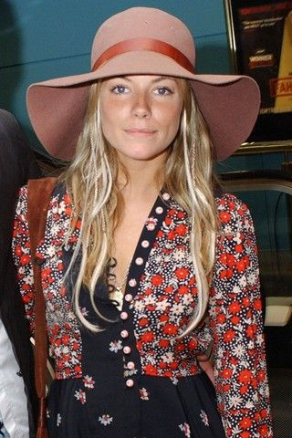 Sienna Miller wearing a vintage printed floral blouse and jacket with 70#s style floppy hat