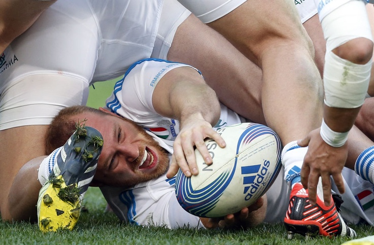 Image 20 of 24: Italy's Leonardo Ghiraldini passes the ball during their Six Nations rugby match against France at the Olympic stadium in Rome February 3, 2013. REUTERS/Stefano Rellandini