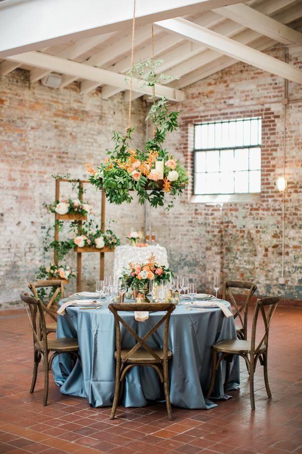 Bakery 105 // A Wilmington, NC Wedding Venue // Flower chandelier by Fiore Fine Flowers // www.southernbrideandgroom.com // @sthrnbrideandgroom