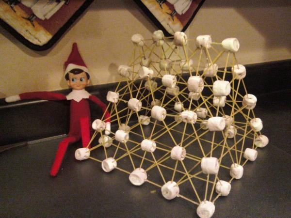 this morning pip is proudly showing off his building techniques... this is a 3D structure made of uncooked spaghetti and marshmellows. it kindda looks a bit like a cage. wait.... where is rudolph??
