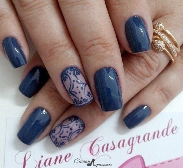 Here is the perfect evening manicure for girls with a refined taste. Elegant dark blue varnish is perfectly with the accent on the ring finger. The design