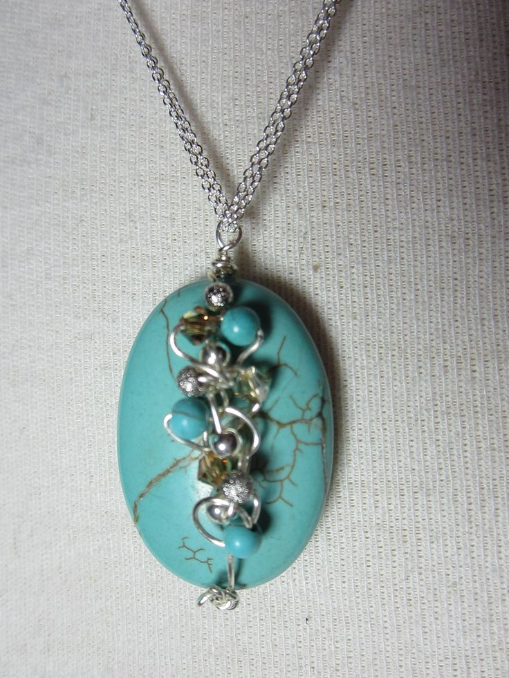Turquoise-dyed stone wrapped with silver wire, mixed crystals and silver beads