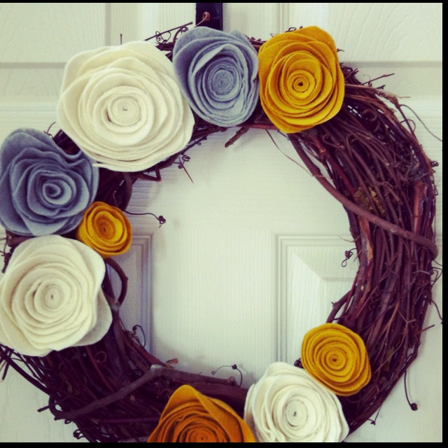 Twine wreath with felt flowers.