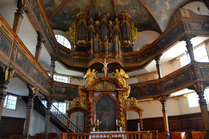 Trinity Lutheran Church, Speyer, Germany. Note the unusual placement of the organ, above the altar. ©Jean Janssen