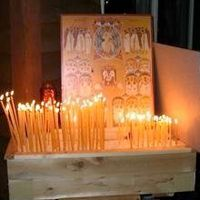 """On Hallowe'en, I sit on the porch of my house with a bowl of candy, a box of beeswax candles, and a large icon for the Feast of All Saints. Every child who comes to the house gets a piece of candy, and may also light a candle and place it before the icon.  For those who ask, I tell them that the meaning of the word """"Hallowe'en"""" is """"the eve of the Feast of All Saints""""...I tell them  that, because of Christ, they can dress up like ghosts and goblins and not need to fear those things any…"""