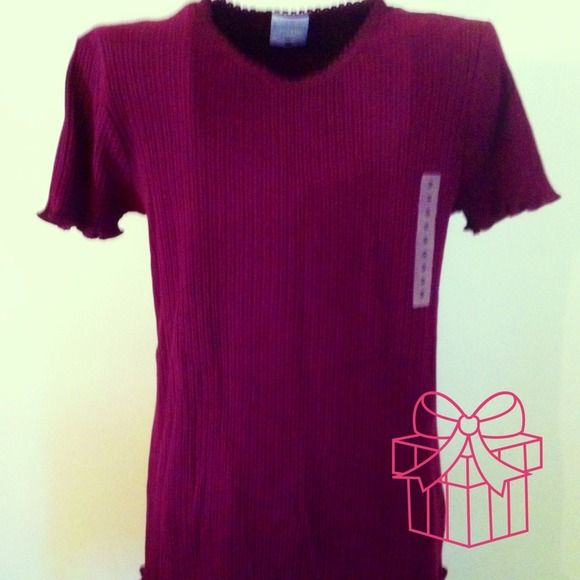 Burgundy Maternity Top This Maternity Top is  without Tags & is 100% Cotton.  Although, it is listed as a Maternity Top it can easily could be worn as an ordinary Top. Motherhood Maternity Tops