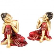 Each Red and Gold Buddha is made from resin, finished in red and metallic gold paint.