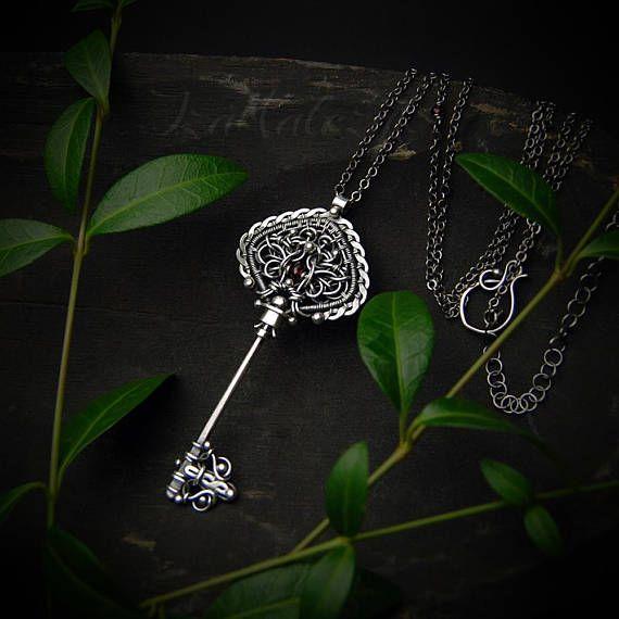 Sinningia  unique key-shaped silver pendant necklace
