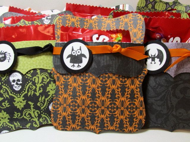 These adorable treat holders are for Halloween but you can make them for any holiday, depending on what paper you use.
