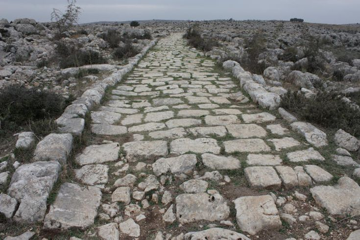 Roman engineering - the roads. The Romans built the finest roads in antiquity. A deep trench was dug, into which was laid a layer of flat stones; next, stones in mortar, topped by concrete or sand or more stones. Finally, cobbles were set in mortar. The edges, unpaved on both sides, functioned as sidewalks.