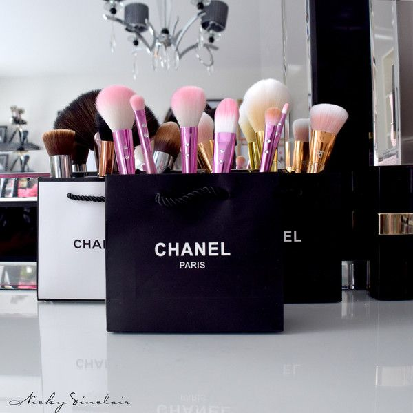 Makeup brushes on display inside Chanel shopping bags