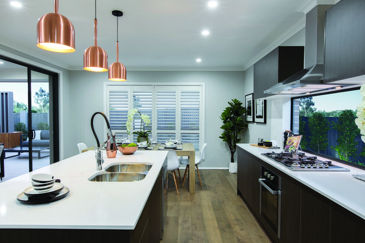 The Bristol Display by Eden Brae Homes NSW http://www.edenbraehomes.com.au/home-designs/bristol/ #EdenbraeHomes #weeklyhometrends #design #styling #newhome #pendantlight #copper #kitchen #dorf #clark #inspiration #blacktapware