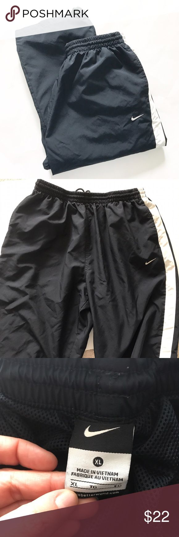 NIKE [men's] Black windbreaker Track Pants Have zippers at ends of legs. Good condition but do have a tiny flaw as pointed out in photo. Not a hole, but defect in fabric. Nike Pants Sweatpants & Joggers