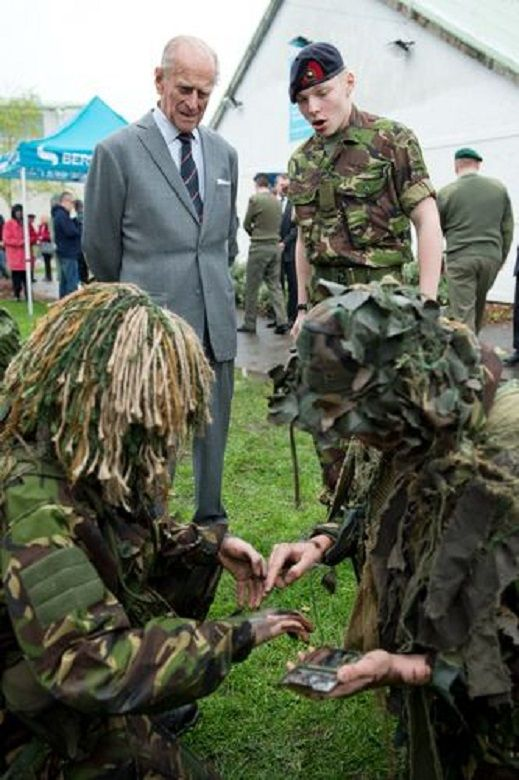 Britain's Prince Philip meets cadets during a visit to the Windsor Sea Cadet Unit in Windsor, southern England on 07.04.14. T.S Windsor Castle is the oldest unit in the Sea Cadet Corps, established in 1899 as a way to provide a small training vessel on the river at Windsor.