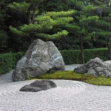 Not all Japanese gardens feature actual water; many represent water with stones, gravel or sand. The sand in this garden has been raked to look like ripples in a pond.