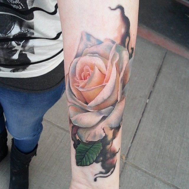 Gorgeous white rose tattoo by @sarahmillertattoo