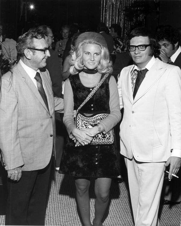 Actor Eddie Bracken, his wife and former Playboy bunny Alene Akins, and Larry King pose for a picture.  (1972) | Florida Memory