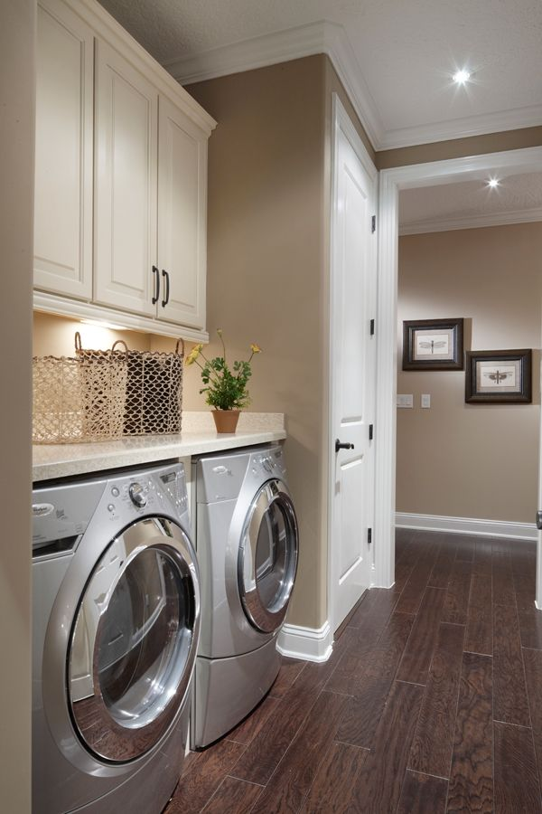 laundry room. I really really want a beautiful room like this to do my laundry. Smooth polished dark wood stain floors and natural tan brown walls. It's like a sanctuary.
