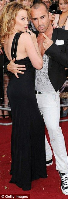 #KylieMinogue and #LouieSpence in 2010 on the #redcarpet with Pineapple Dance Studios' Louie Spence at the Sex And The City 2 premiere in London   @dailymail   Read more: Dailymail.co.uk