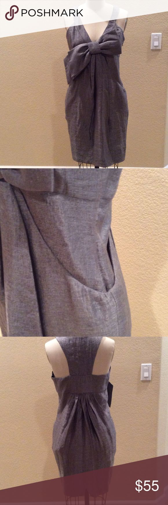 Bcbg silver jumper Perfect holiday party dress w/ front bow.  Tag says size 10, but it fits more like a size 6. Roomy dress in general. Never worn in perfect condition. BCBGeneration Dresses