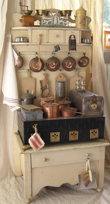 German child's kitchen cupboard with stove, ca 1910.