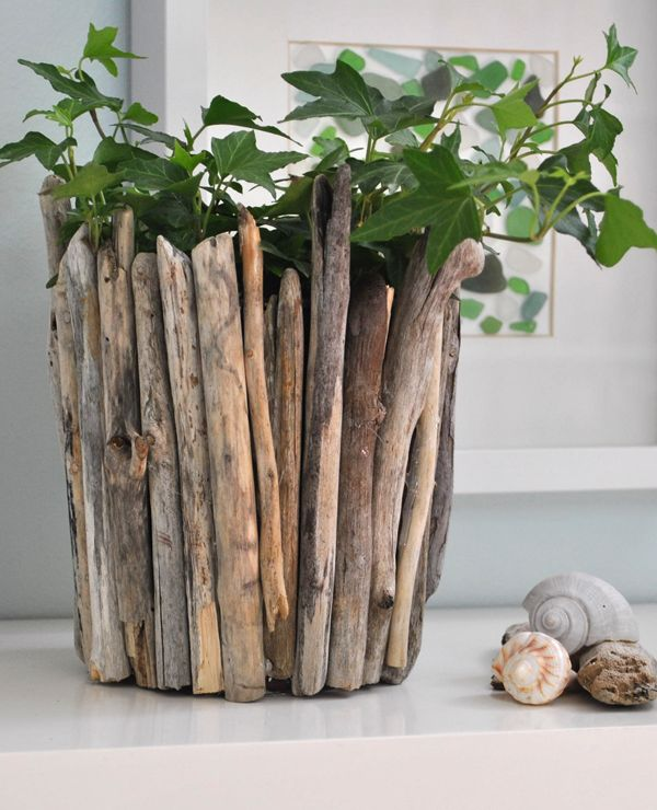Use driftwood (or even branches collected from the yard!) and an empty container to make this pretty vase. It's easy, inexpensive and fun!