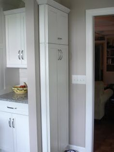 Superior Narrow Kitchen Cabinet Command Center Added To End Of A Bank Of Cabinets  Broom And Mop Storage