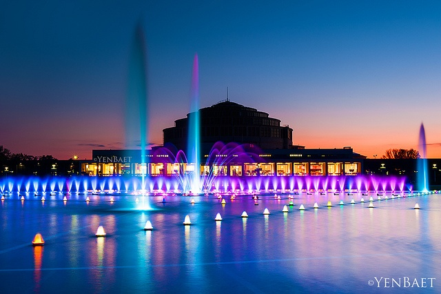 Wroclaw, Poland - Centennial Hall and the Multimedia Fountain - Photo © www.YenBaet.com. The Wrocław Fountain or Wrocław Multimedia Fountain is a multimedia fountain located within the Pergola next to Centennial Hall in Wrocław. The one-hectare fountain incorporates about 300 jets to create a screen of water for animation display. There are also 800 lights. When frozen in winter, the fountain is a 4700-square-metre ice skating rink.