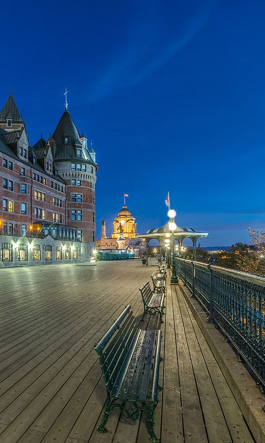 Dufferin Terrace behind Chateau Frontenac has a broad boardwalk with views of the St. Lawrence River and Lower town.  Upper town Quebec City.