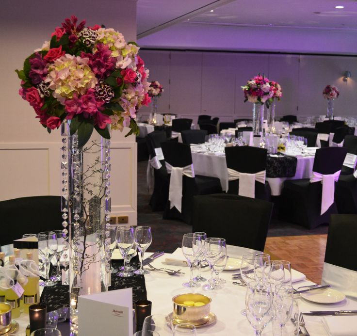 Tall pink floral arrangements with crystal garland strands. Styled by Greenstone Events.
