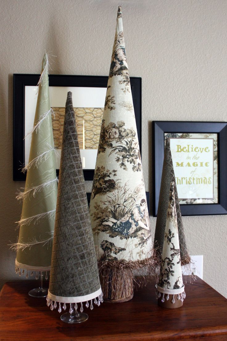 Fabric covered trees from poster board.  Great instructions that can made to work with any decor. I used wine glass because I didn't have enough candle holders to use for the bases. Fun project!