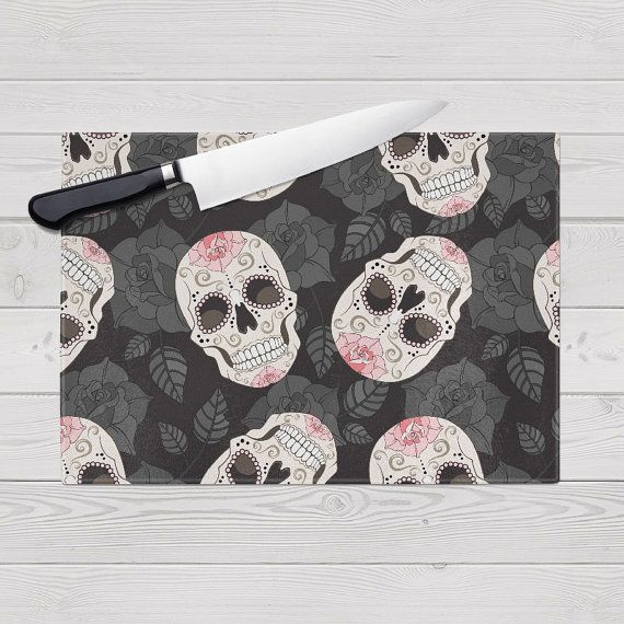 Fantastic Glass Cutting Board with a fun Sugar Skull Motif. These cutting boards feature rubber feet to prevent slipping, a nice textured surface to