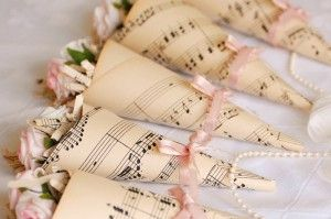 Rose petals and vintage music sheets.