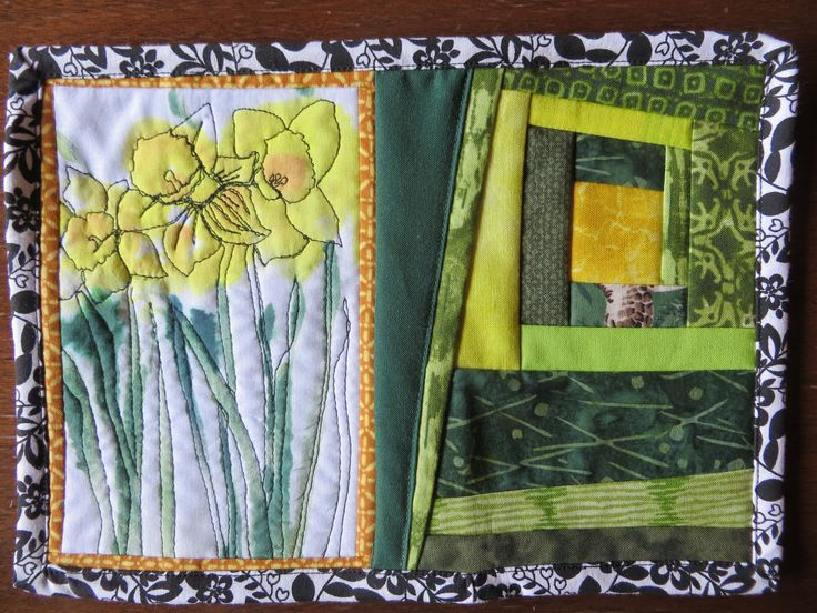 Daffodils sewn in thread onto dyed fabric.