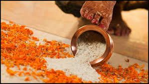 A vessel filled with rice is placed at the entrance of the groom's home. The bride is supposed to spill the rice by touching it with her right foot to signify wealth and that the bride accepts her new responsibilities.