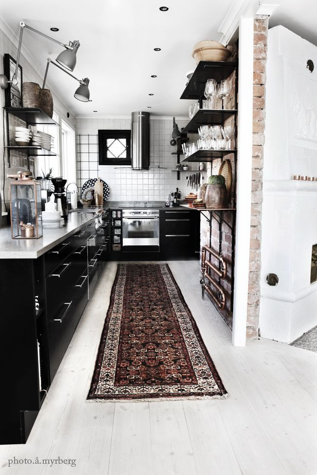 Black & white kitchen - love the runner & brickwall. Add in a few pops of red & this could be my dream kitchen.