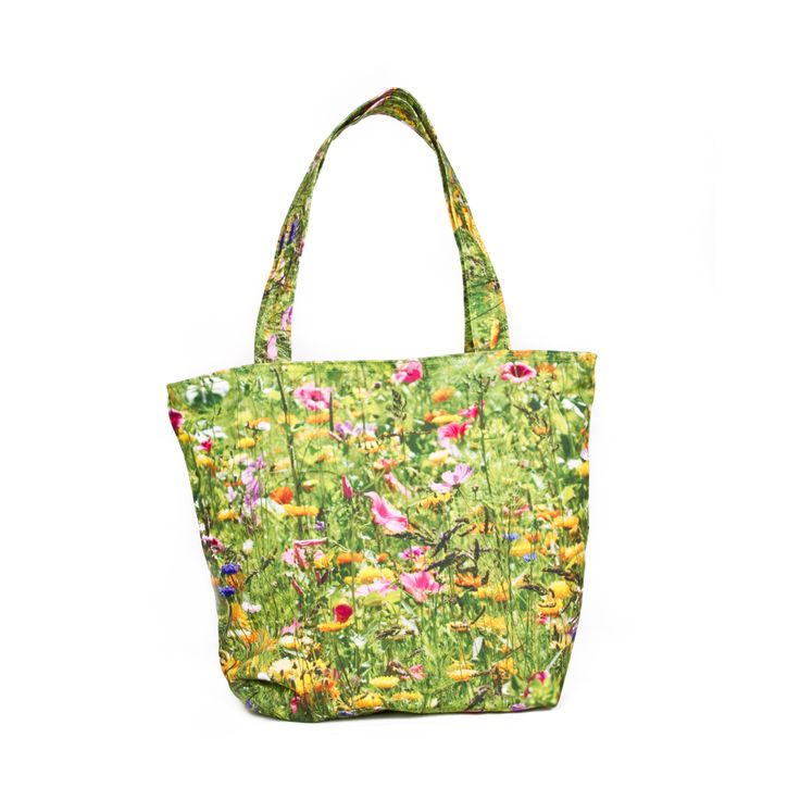 Moulin d'Amour, Normandy, France    Just like a painting, this field of blossoming flowers cover the mass of green and turns it into a magnificent beauty of transcending colors. This very lively and cheerful bag can be carried out to show off the dainty colors of the flora. This delightful bag is fashionable and wearable for those long sunny days.