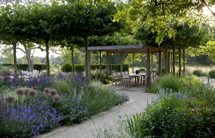 A Cotswold Taverna A private garden designed by Marcus Barnett. A very relaxing spot photographed on the hottest day of the year. Location: Gloucestershire