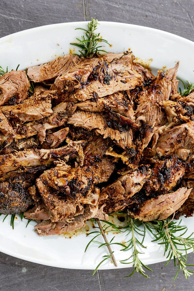 "The British-by-way-of-Jerusalem chef Yotam Ottolenghi cooked this recipe as part of what he called ""a Middle Eastern take on a proper English garden party."" He raises high the street-meat ideal of shawarma, resulting in a deeply flavored cut of lamb. The lamb would ideally meet the spice mix the day before it is cooked, so it takes some time, but not much work. (Photo: Carol Sachs for The New York Times)"