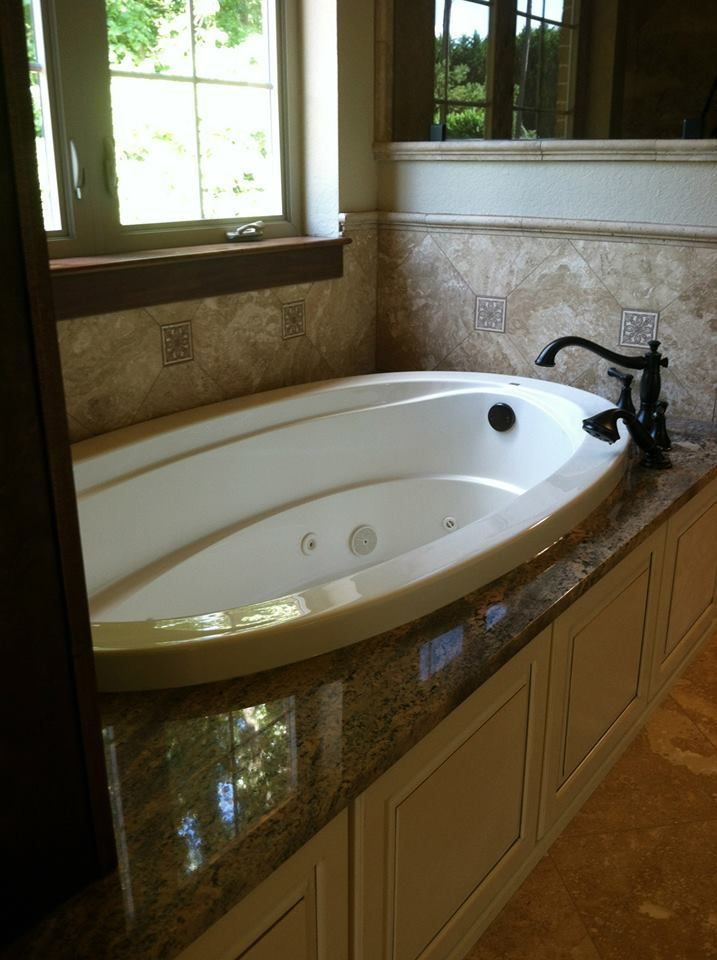 granite around a bathtub. knoxville's stone interiors. showroom