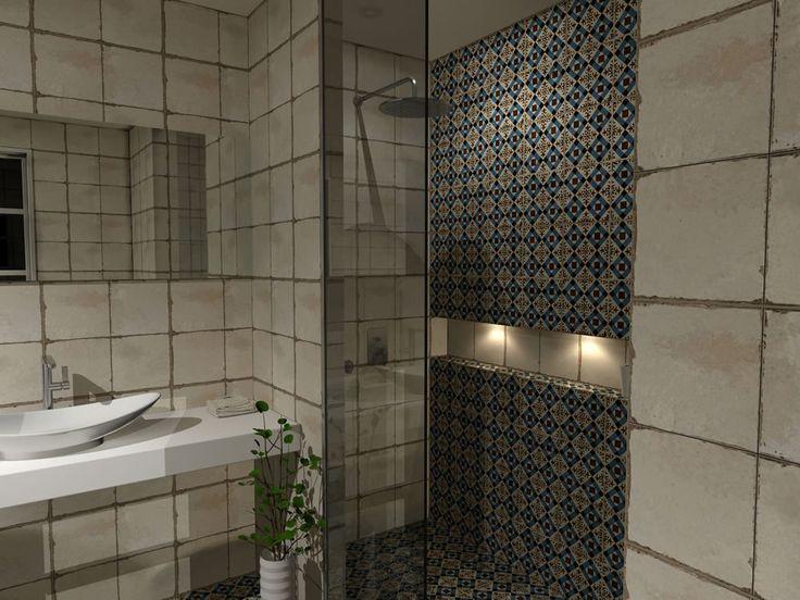 Ο χώρος της ντουζιέρας οριοθετήθηκε από το υπόλοιπο μπάνιο με κρύσταλλο ασφαλείας με πάχος 10 mm. Το κρύσταλλο προτιμήθηκε να τοποθετηθεί μέχρι την οροφή του μπάνιου. Στο εσωτερικό της ντουζιέρας εντοιχίστηκε ειδική μπαταρία με μεγάλη κεφαλή ντους και τηλέφωνο χειρός.