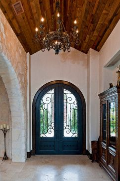 Santa barbara style in austin mediterranean entry for Mediterranean style entry doors