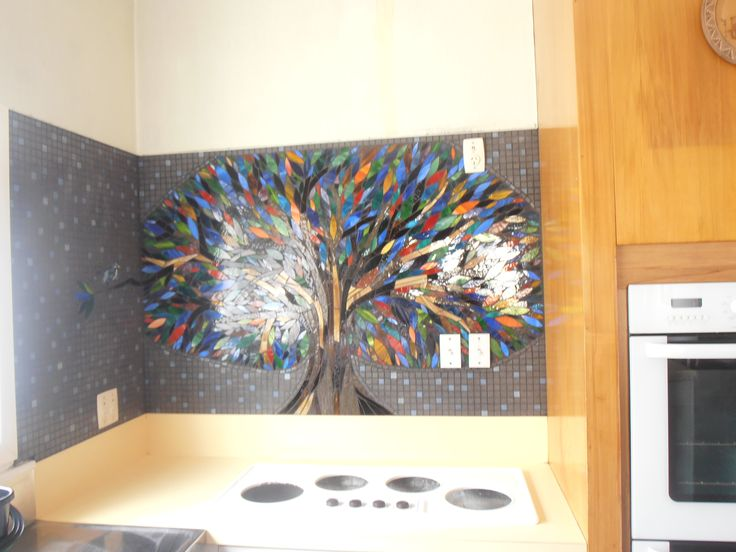 Mosaic/Glass Splashback 2metres wide 1.2metres high, featuring 900+ handcut leaves in an amazing array of various glasses and colours, surrounded by vitreous tiles.