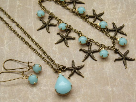 Sky blue glass rhinestone set ♒ Starfish Jewelry Set ♒ Summer Jewelry    Inspired by this Spring/ Summer 2014, this set is part of my new Beach Collection. A starfish jewelry set of vintage style look and sky blue rhinestone glass on patina brass settings, dangling from a good quality texture antique brass chain.  The set includes necklace, bracelet and earrings. Perfect for a summer party, for spring celebration or even for everyday wear. ☼ Length on the necklace is 18 inches.  Bracele...