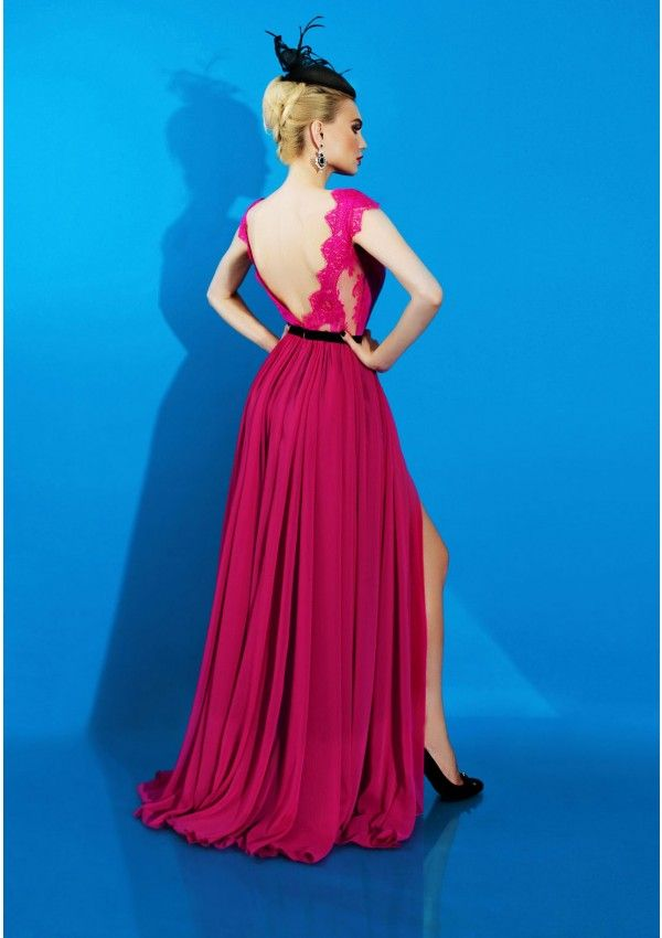Be the center of attention in this vibrant pink, spectacular, evening gown. Featuring a delicate lace bodice with a asymmetrical silk veil, this flattering cocktail dress is all you need for a look which will definitely be remembered. With a V deep cleavage in the back the new Romantics dress is your sex-appeal secret tool.