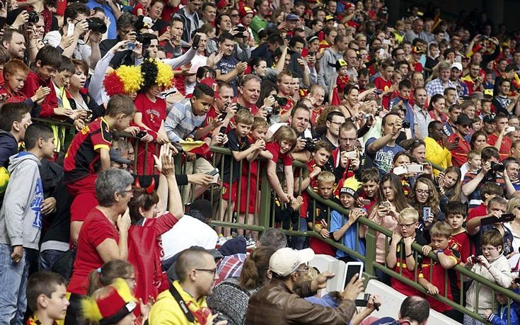 Belgium's supporter's attend the last training session of Belgium's national football team, the Red Devils, before their departure